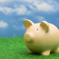 Savings piggy bank with clouds
